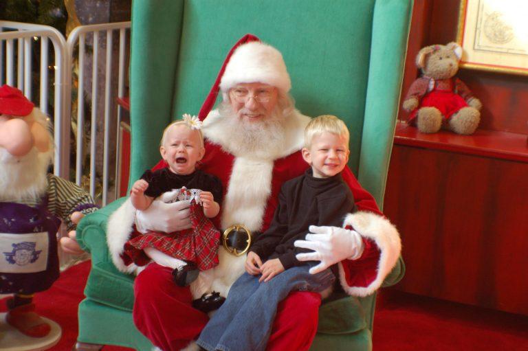 The kids sitting on santas lap